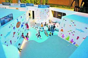 兒童玩樂天地空間寬敞,牆壁用色豐富,且備多項設施供兒童及家長使用。(會所模型)