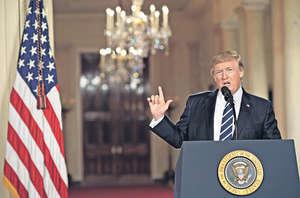 美國總統特朗普一上任便急推新政,有可能由此引發各類紛爭,包括軍事衝突、貿易戰、貨幣戰及金融戰等。 (法新社資料圖片)