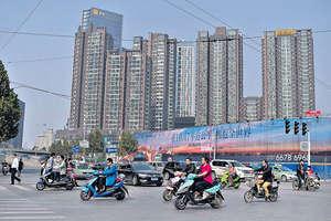 中國金融危機是否爆發,完全取決於內地各城市的房價是否會暴跌,而各城市房價上漲是離散性的,那麼其房價下跌也是離散性。(法新社資料圖片)