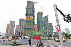 今年《政府工作報告》中的房地產政策的意圖十分明顯,就是讓去年的政策在今年向全國延伸,又一次打造中國的房地產市場繁榮。(中新社資料圖片)
