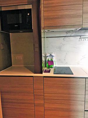 木紋廚櫃設計,感覺和諧自然。(相片由代理提供)