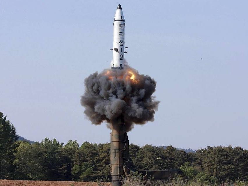 北韓發布未標明日期的試謝導彈照片。