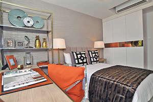 上層其中一間睡房與主人房同向,望會所泳池景,並備有書枱,為戶主提供寧靜的工作空間。(本刊攝影組)