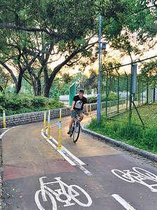 單車代步能為市民於繁忙的生活提供適當運動的機會,政府應致力把單車配套融入城市規劃中,打造香港成為單車友善城市。(資料圖片)