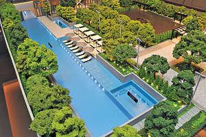會所採雙泳池設計,其中室外泳池長約50米,被綠色植物包圍。(會所模型)(本刊攝影組)