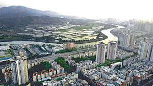 隨着大灣區發展,中港融合勢必又再成為社會議題。圖為深港相連的深圳河。(中通社資料圖片)