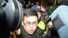 台灣新黨發言人王炳忠疑涉國安法,被調查局人員帶離住處調查。(中央社圖片)