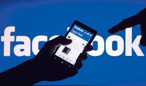 Facebook宣布修改動態時報的顯示方式,優先顯示用戶親友的帖文,並降低非廣告專頁內容。(路透社資料圖片)