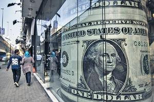 當全球經濟形勢良好時,過強的美元將被拖回長期貶值通道,而大宗商品價格有望進一步上行。(法新社資料圖片)