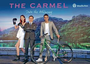 永泰地產發展執行董事兼銷售及市務總監鍾志霖(中)表示,屯門項目命名靈感源自美國加州中部海岸的高尚度假勝地Carmel。(陳靜儀攝)
