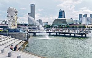 新加坡當局考慮放寬住宅短期放租限制,被視為對Airbnb開綠燈。(法新社資料圖片)