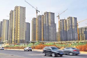 內地許多城市的房地產價格和銷售開始下滑,房地產開發投資正在減速。(中新社資料圖片)