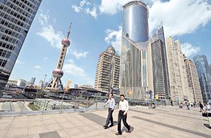 2015年內地的經濟增長速度可能繼續放緩,城鎮就業情況預計將保持基本穩定。(法新社資料圖片)