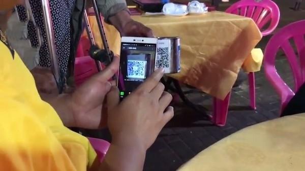 用QR碼討錢,今天乞丐也玩高科技。