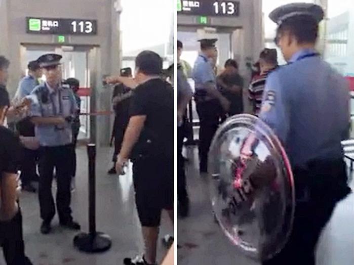 手持盾牌的警察出動,制伏鬧事男子。