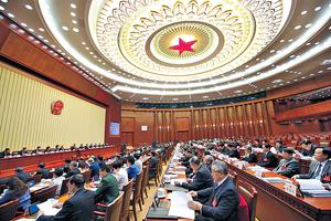 今年北京人大、政協兩會由3月3日政協揭幕,到預計20日人大閉幕,會期料是近年來較長的一次。圖為上屆人大在北京人民大會堂會議情況。(中新社資料圖片)