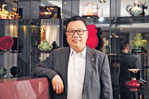 中華廠商聯合會副會長吳國安認為,中美貿易戰對港商的影響更甚於金融海嘯。(程志遠攝)